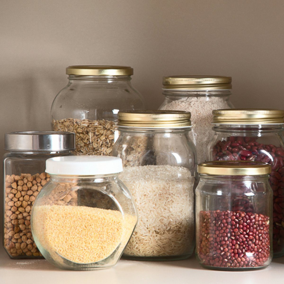 Collection of grain products in storage jars in pantry
