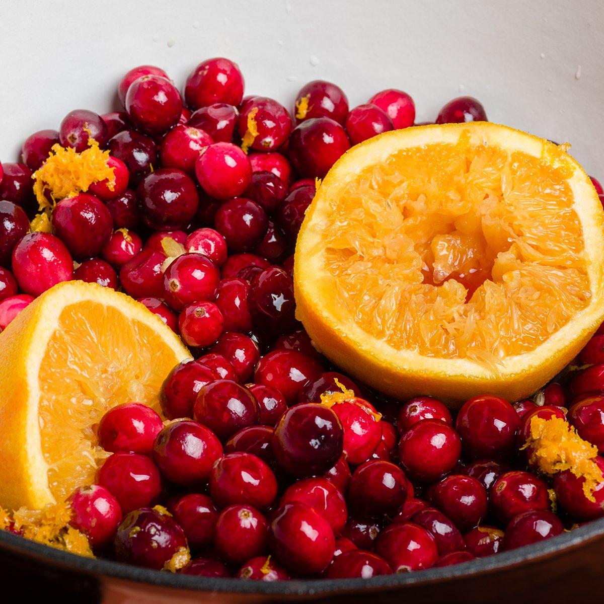 Cranberries and orange for making homemade cranberry sauce; Shutterstock ID 164156969; Job (TFH, TOH, RD, BNB, CWM, CM): TOH