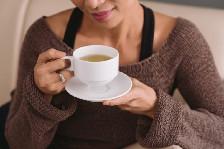 Woman drinking ginger tea