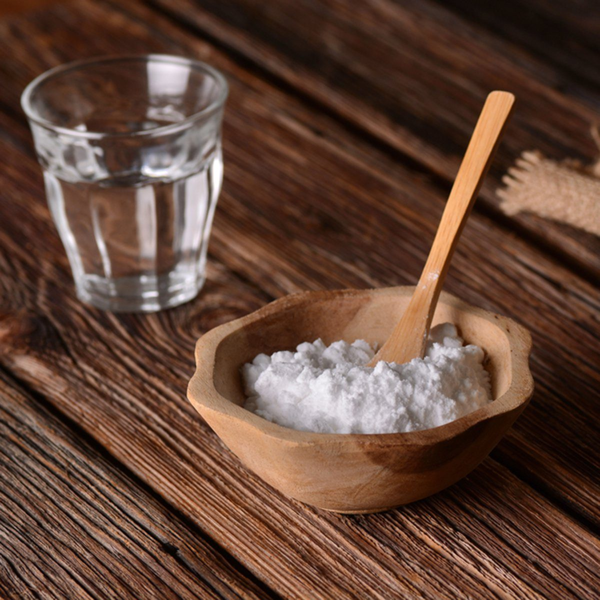 baking soda into the bowl with wooden spoon