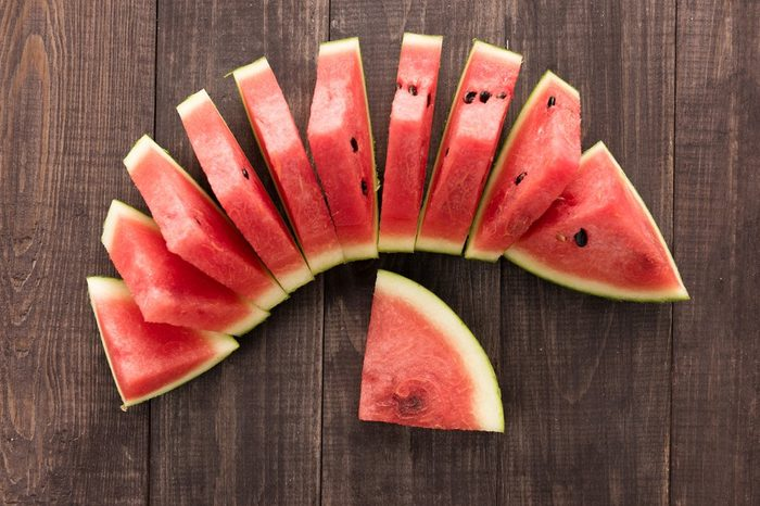 Slices of fresh watermelon on wooden background.