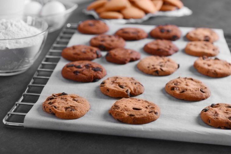 Freshly baked cookies on tray rack