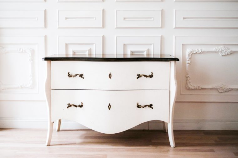 white chest of drawers in white interior