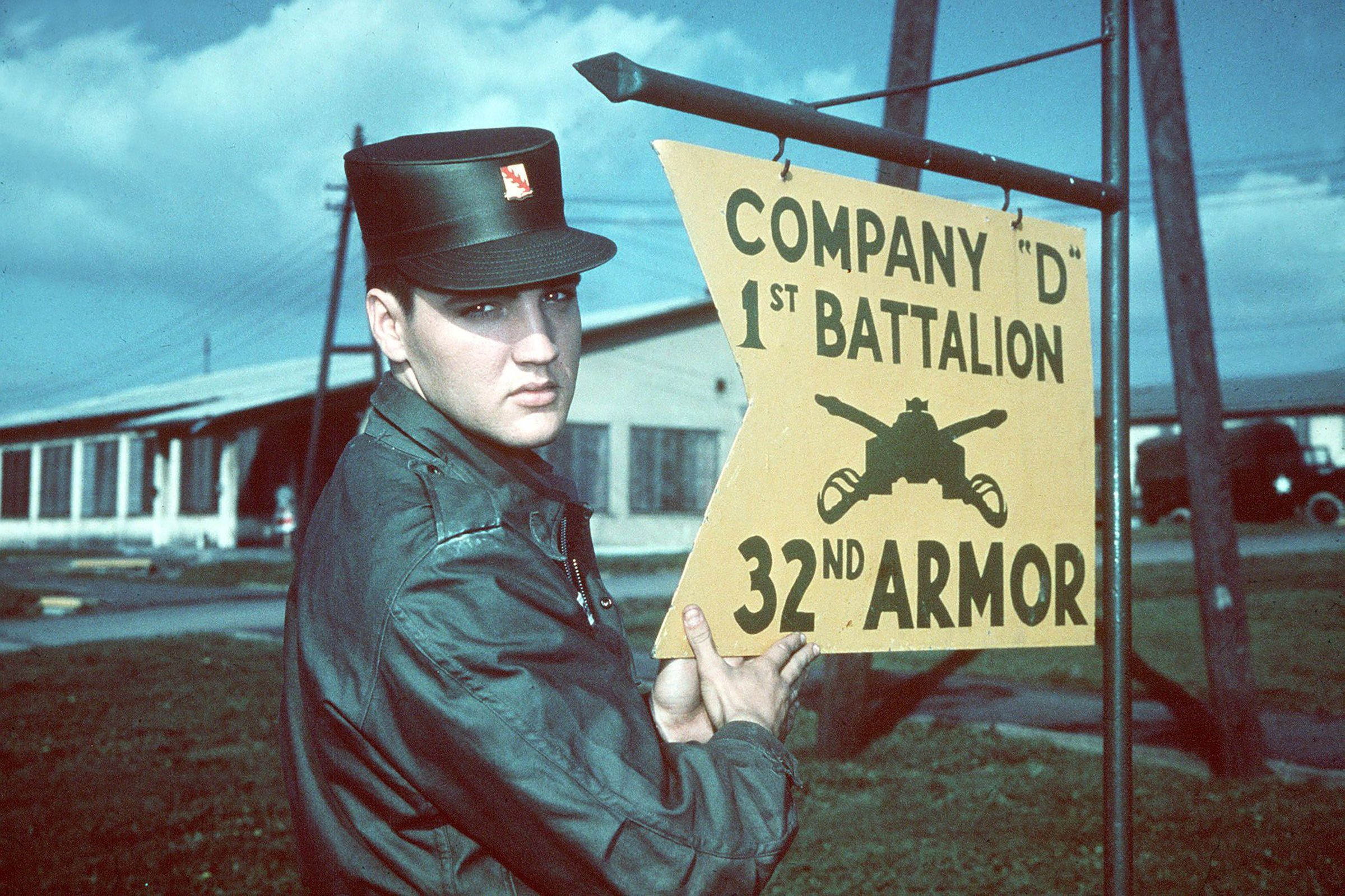 """Mandatory Credit: Photo by AP/Shutterstock (7395468a) ELVIS PRESLEY: ... the """"Pelvis"""", in Army uniform at Company """"D"""" 1st Battalion 32nd Armor, barracks area, Friedberg, West Germany. Undated picture Elvis Presley, FRIEDBERG, Germany"""