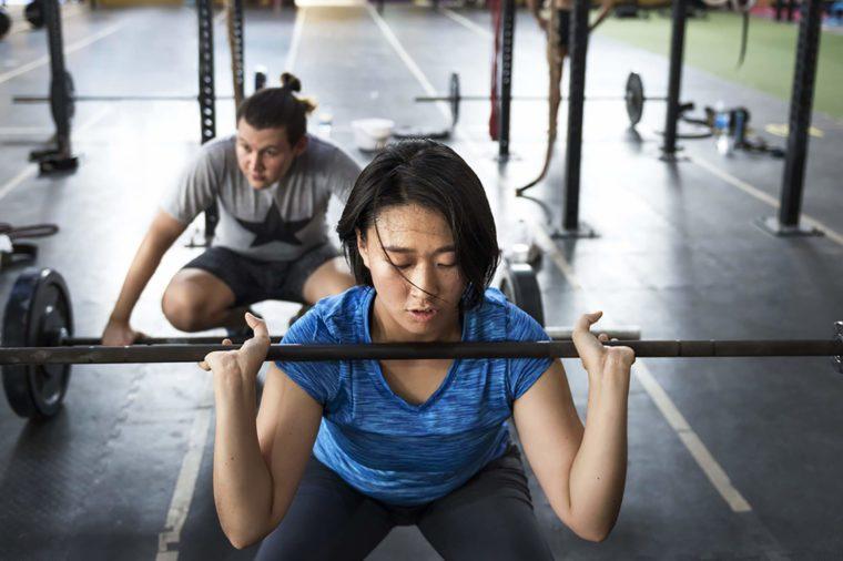 Active woman lifting weights