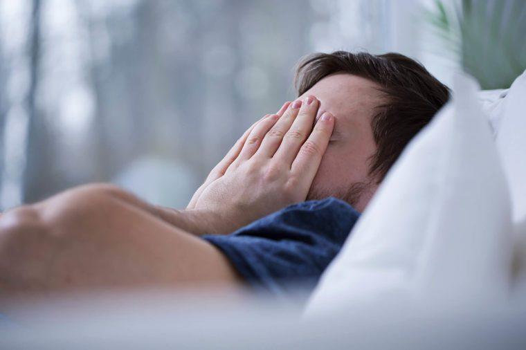 Man experiencing sleep deprivation