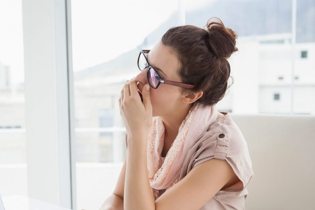 Woman at work yawning