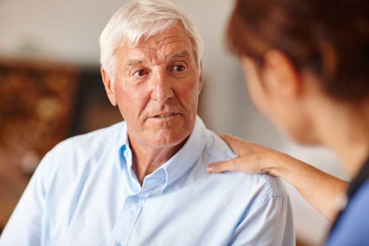 older man talking to his doctor
