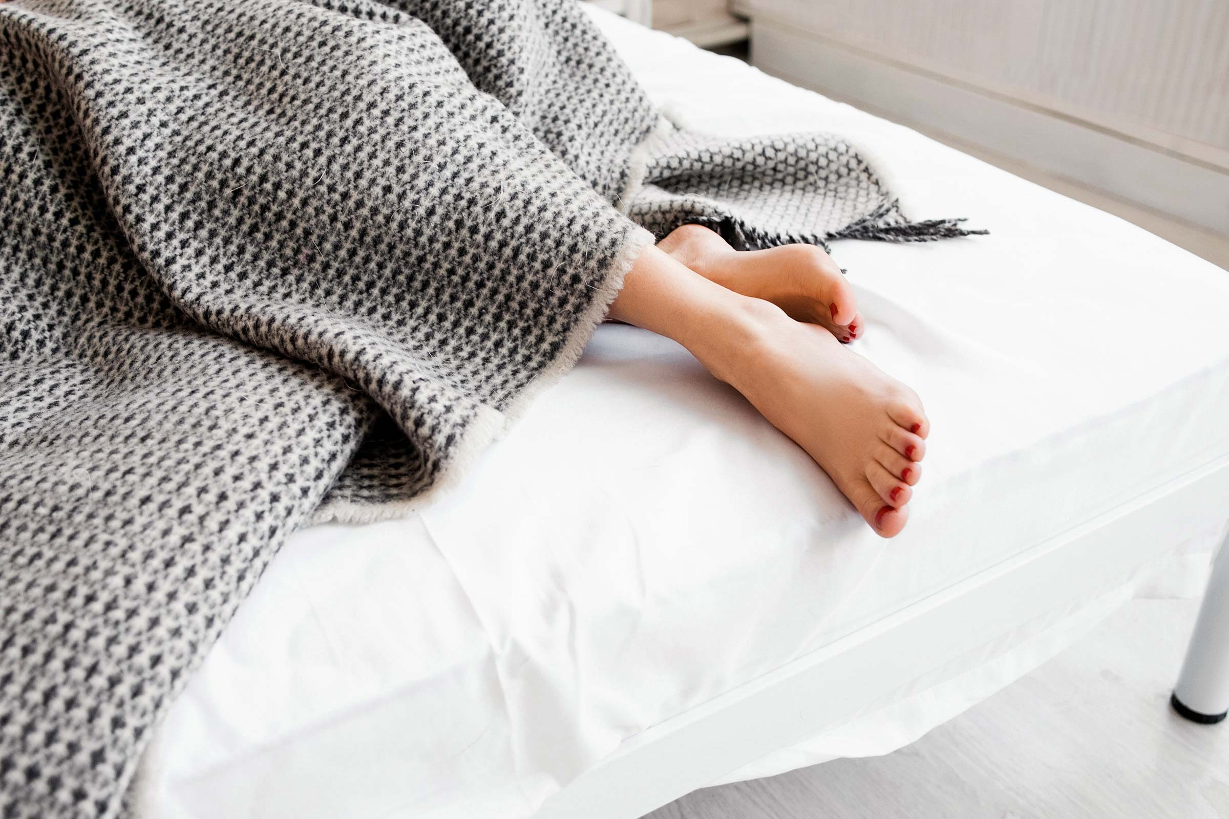 feet sticking out from blanket