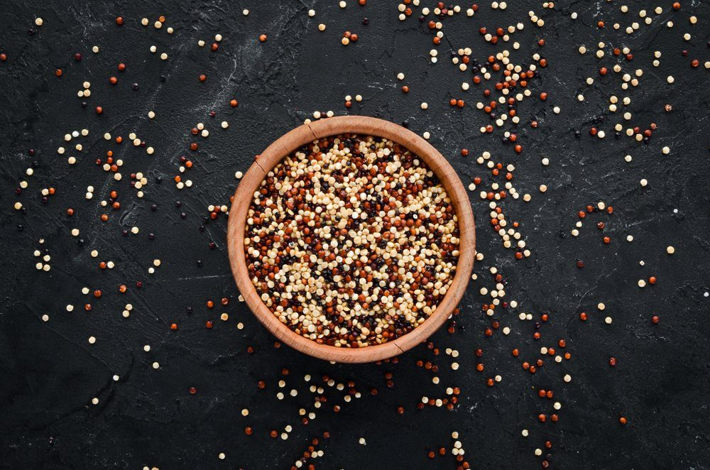Set of quinoa Red, white and brown quinoa. On a black background. Top view. Free copy space.