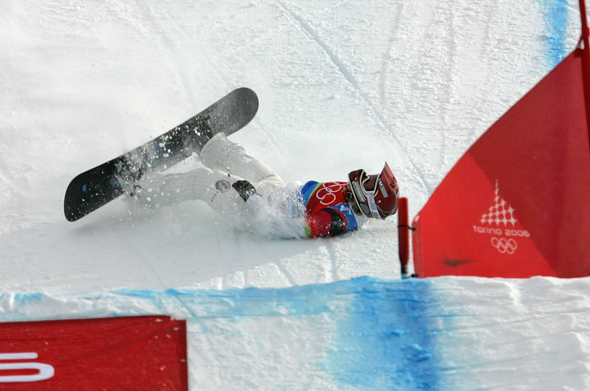 Mandatory Credit: Photo by Lionel Cironneau/AP/Shutterstock (6392064d) JACOBELLIS American Lindsey Jacobellis who was leading in the final of the Women's Snowboard Cross competition, crashes in sight of the finish at the Turin 2006 Winter Olympic Games in Bardonecchia, Italy, . Tanja Frieden of Switzerland won the race to take the gold medal, Jacobellis finished second to take the silver medal, and Dominique Maltais of Canada bronze WINTER OLYMPICS SNOWBOARD CROSS USA TR1, BARDONECCHIA, Italy