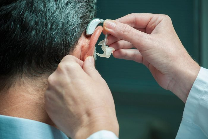 person being fitted for hearing aid