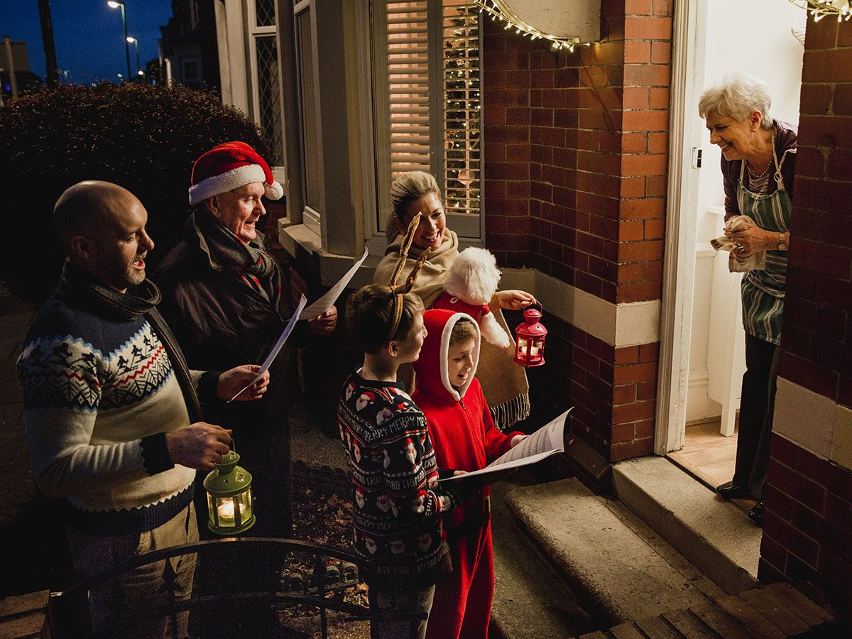 Christmas carollers wassailing