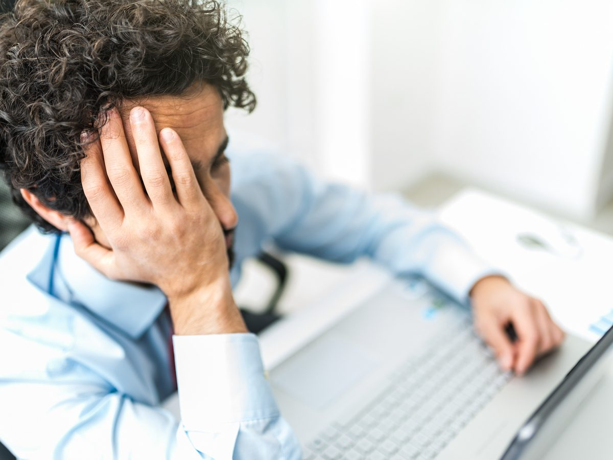 Businessman stressed out about slow computer