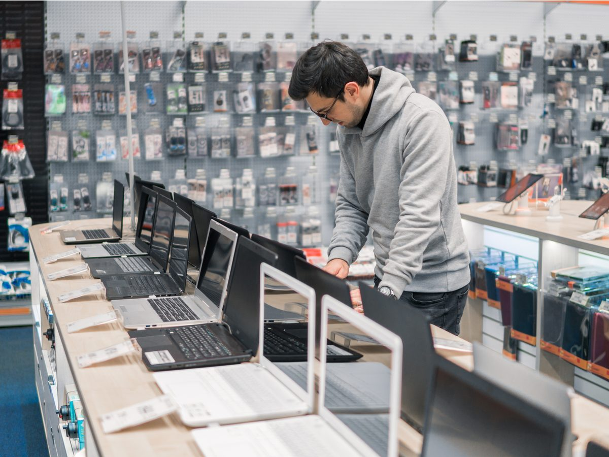 Man at department store buying laptop