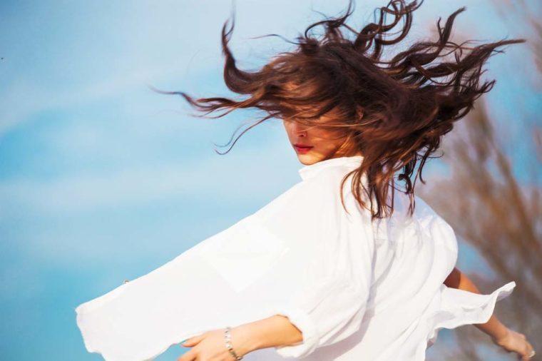 Woman in white shirt dancing