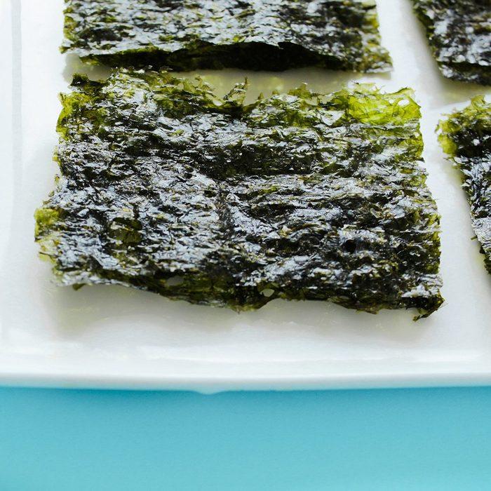 Dry korean organic seaweed isolated on blue background.