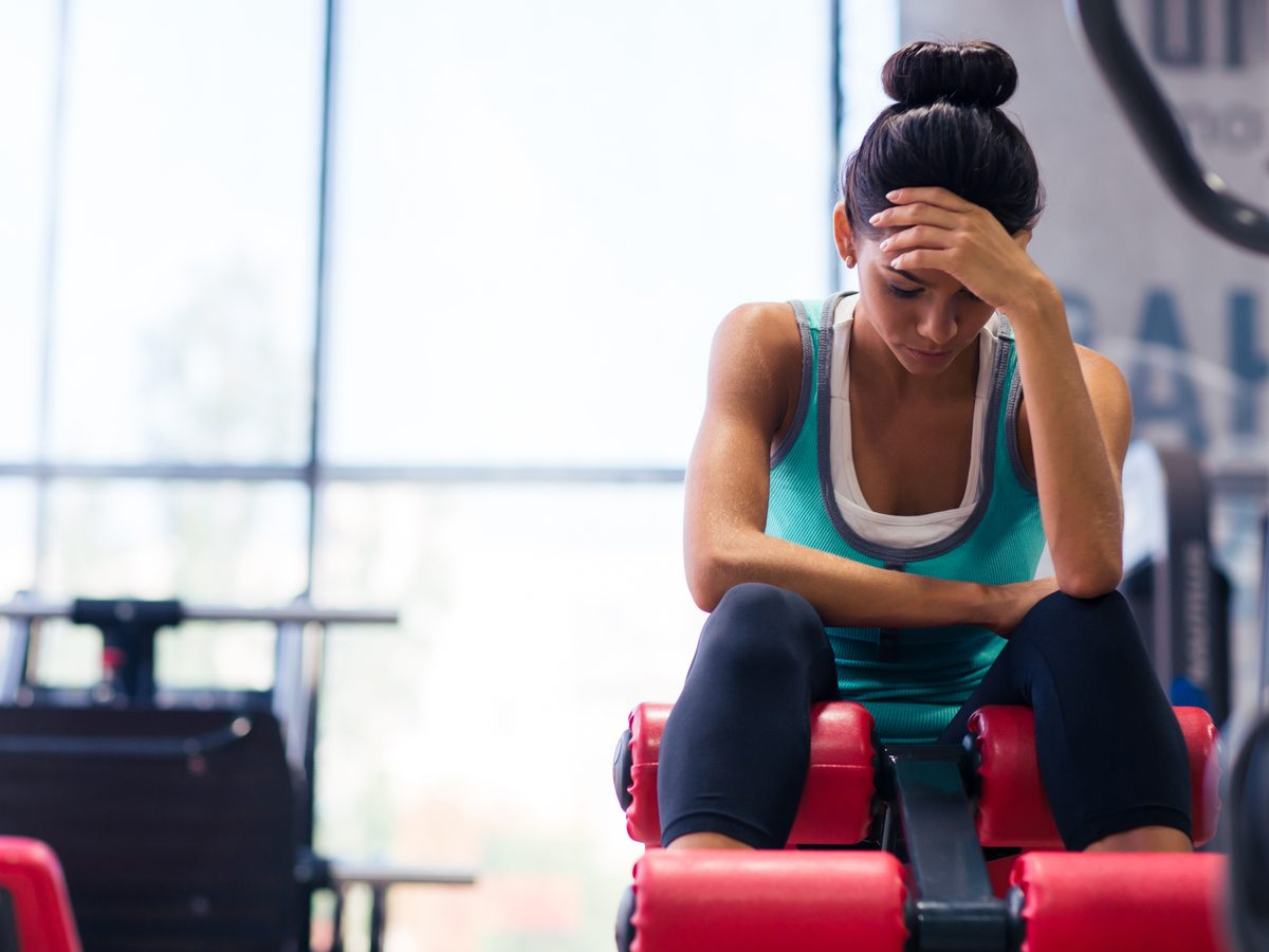 Woman at the gym exhausted
