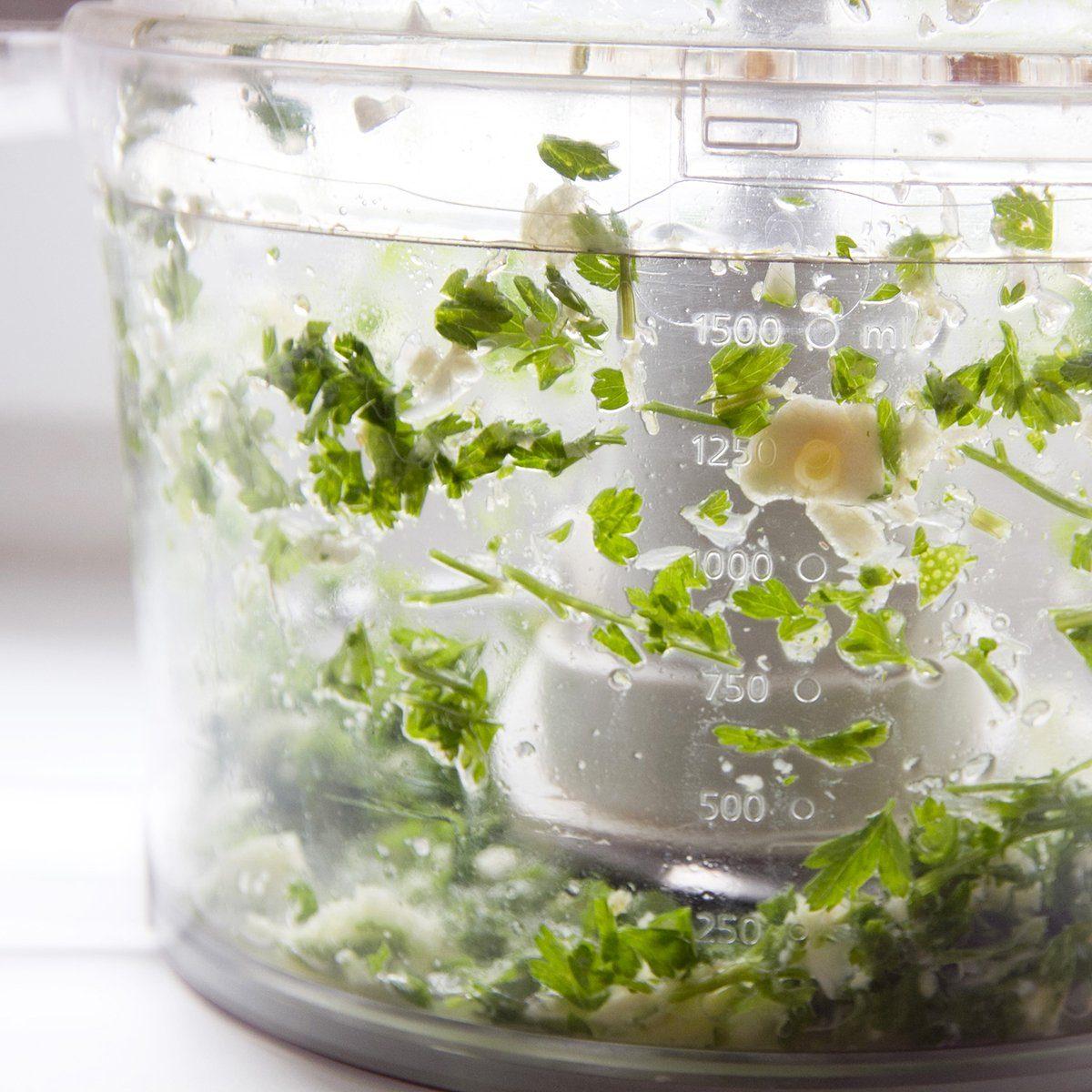 Blending herbs in food processor; Shutterstock ID 1170676570; Job (TFH, TOH, RD, BNB, CWM, CM): TOH