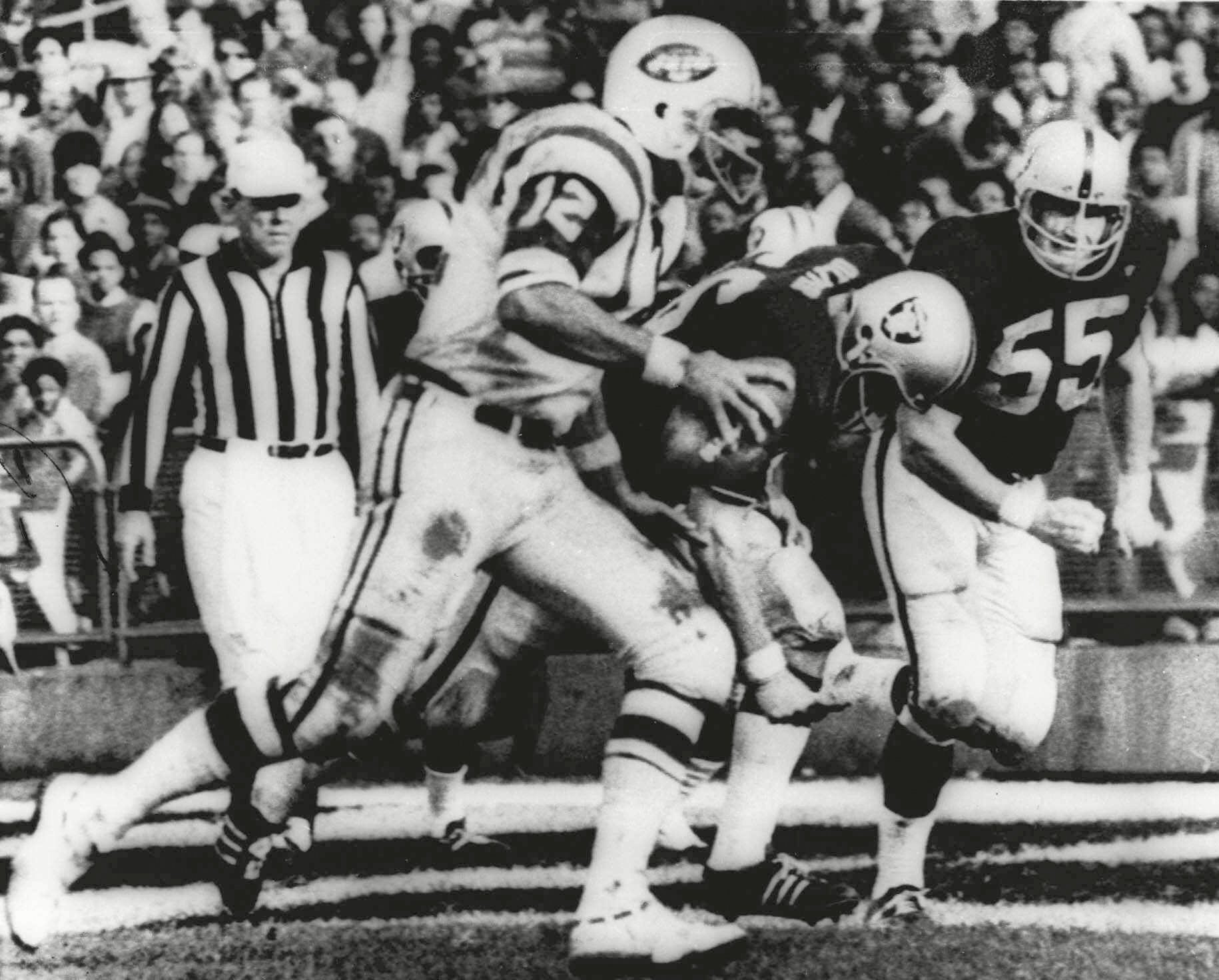 """Mandatory Credit: Photo by Uncredited/AP/Shutterstock (10479900a) HEIDI. New York Jets' quarterback Joe Namath (12) sweeps around the right side past Oakland Raider defenders Ralph Oliver (56) and Dan Conners (55) to score from the one-yard line during the second quarter of a football game at Oakland Coliseum in Oakland, Calif. The Jets were leading 32-29 when the childrens classic """"Heidi"""" began on NBC, interrupting the final minutes of the game which the Raiders won 43-32 in one of the most dramatic rallies in AFL history Game of the Week Analysis Football, OAKLAND, USA - 17 Nov 1968"""