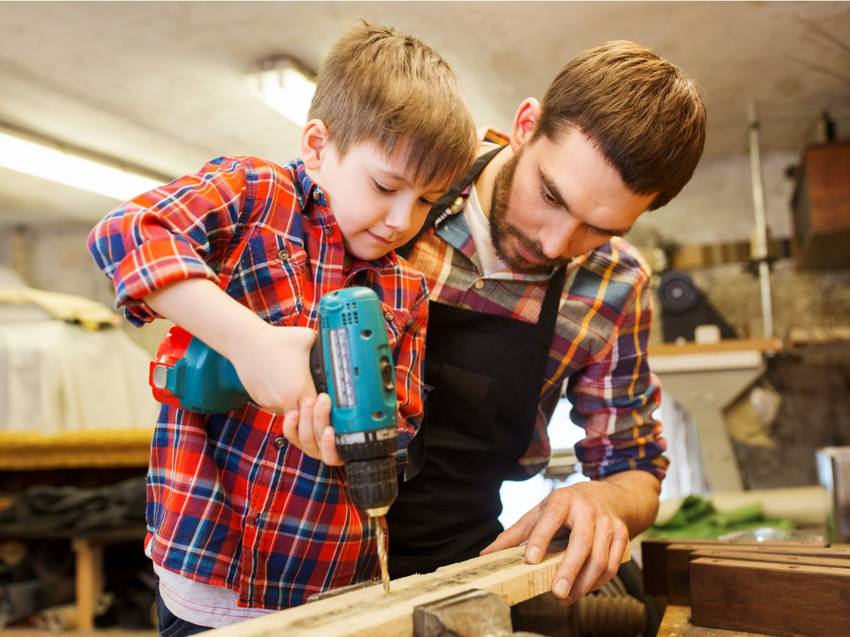 Father and son working on woodwork