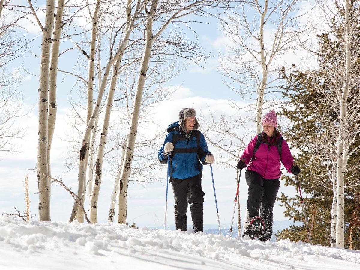 Two female hiking in winter landscape