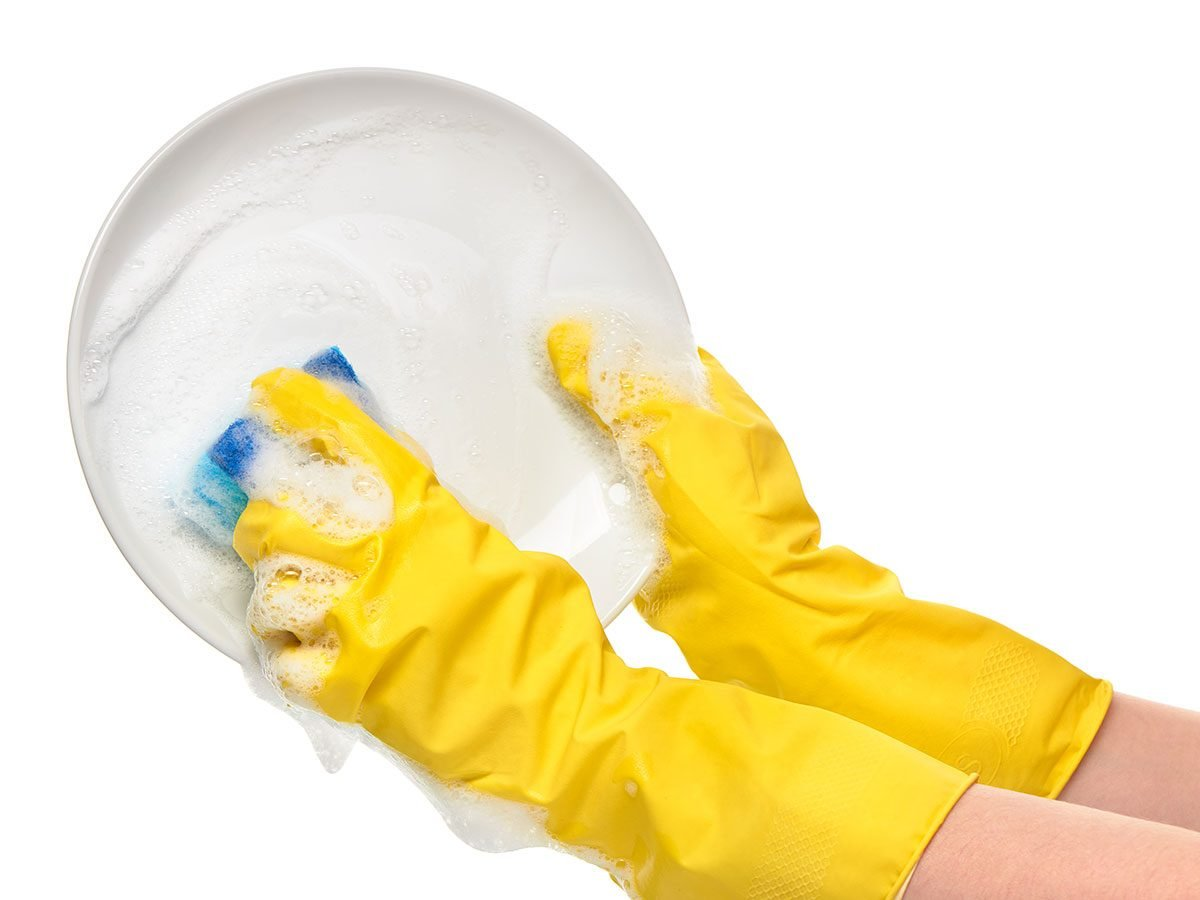Good party guests help clean up wash dishes