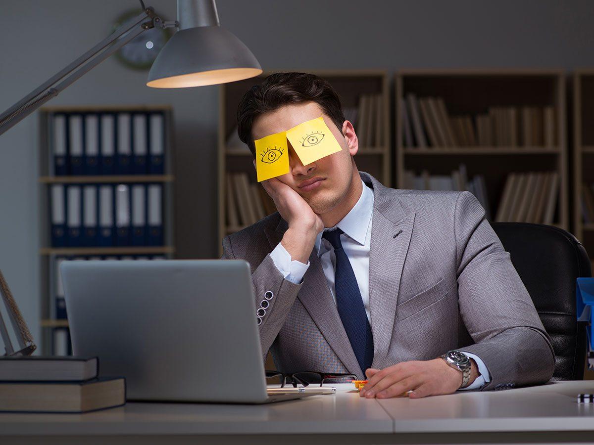 Hilarious work jokes - Businessman asleep at desk in office