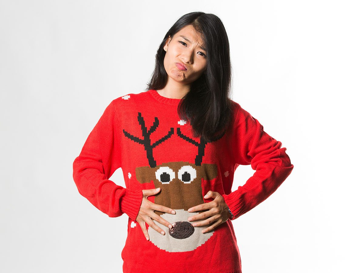 Holiday disasters - ugly Christmas sweater overindulged