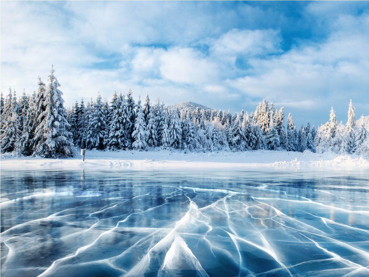 Frozen lake in winter mountains