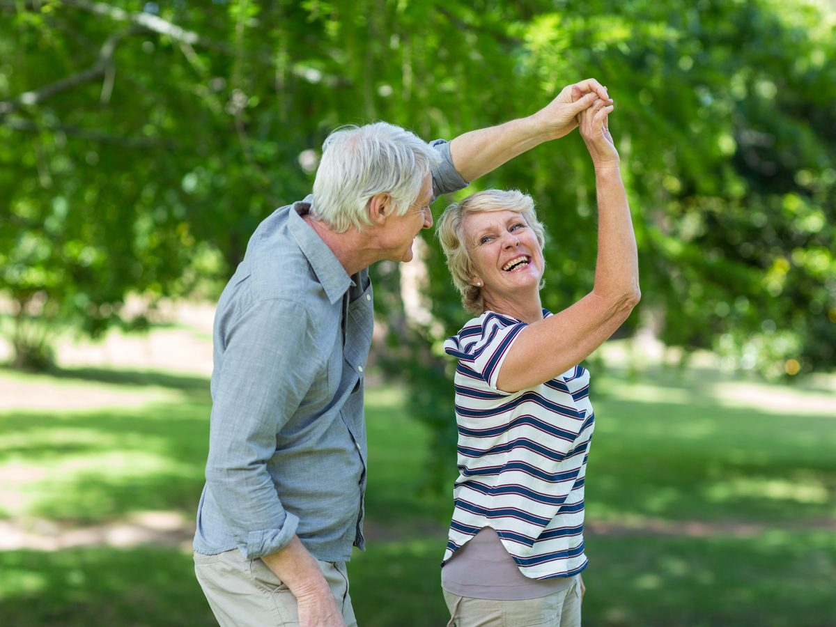 Seniors dancing in park