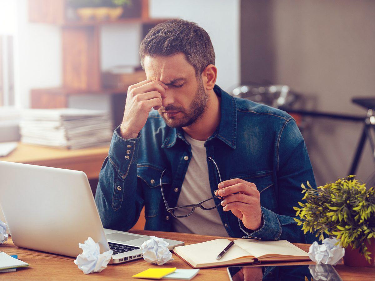 Man stressed at desk