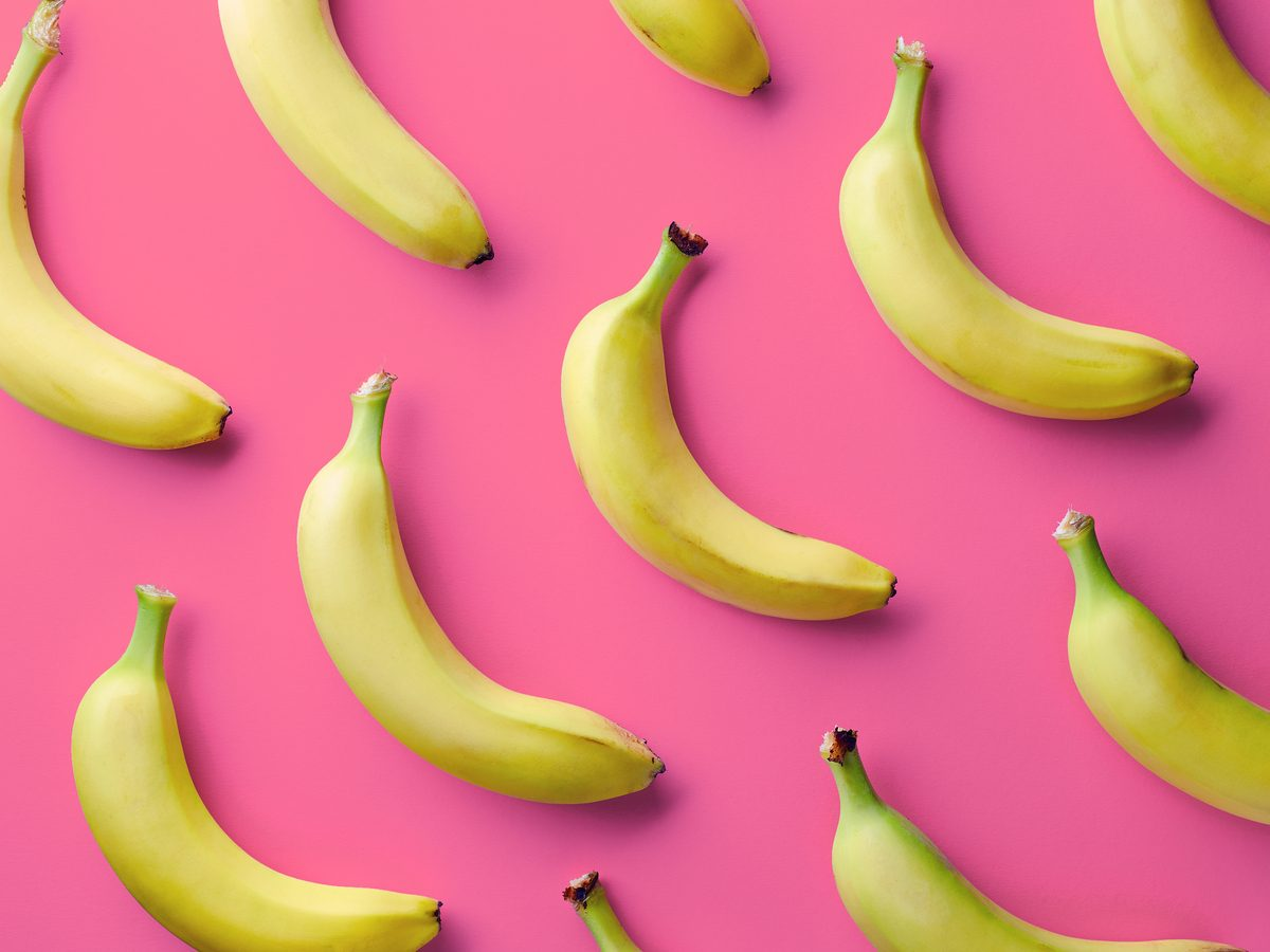 Yellow bananas against pink background