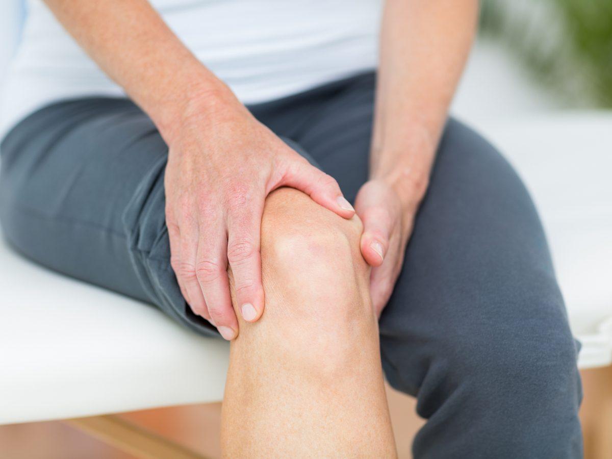 Woman experiencing knee pain