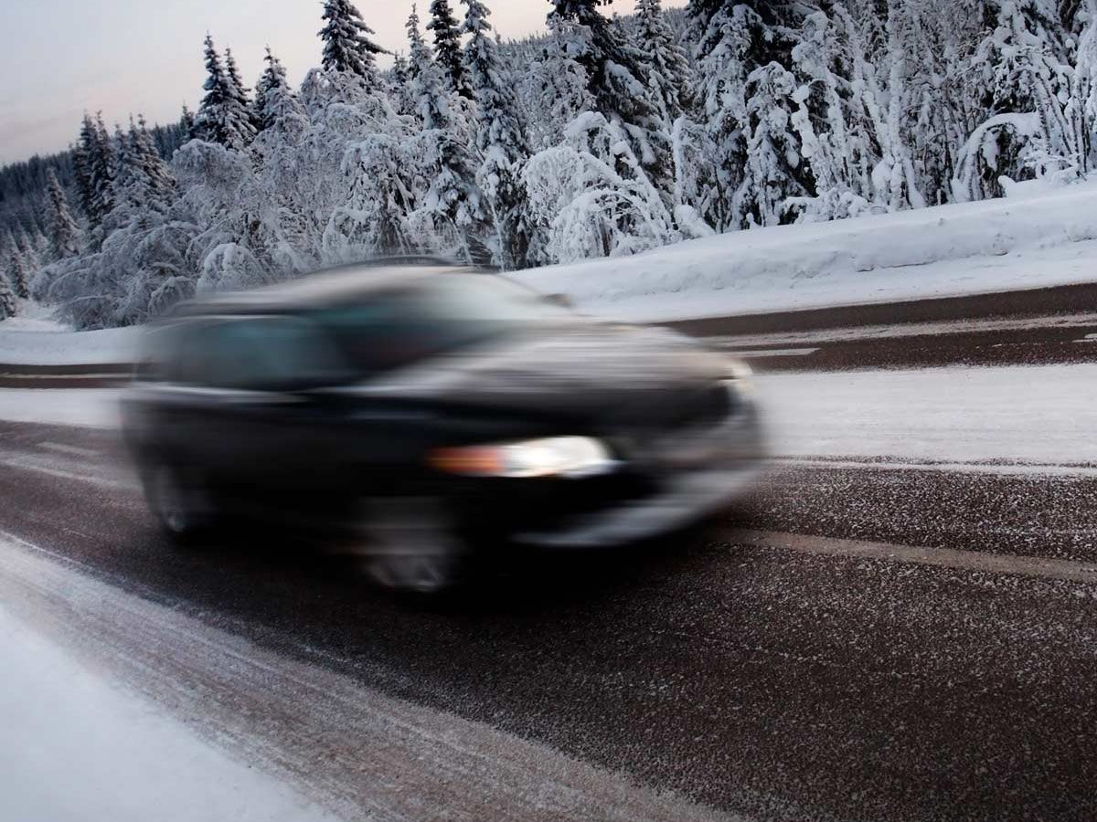 Speeding car on winter road
