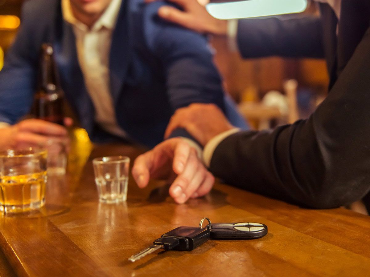 Man convincing his friend not to drive intoxicated