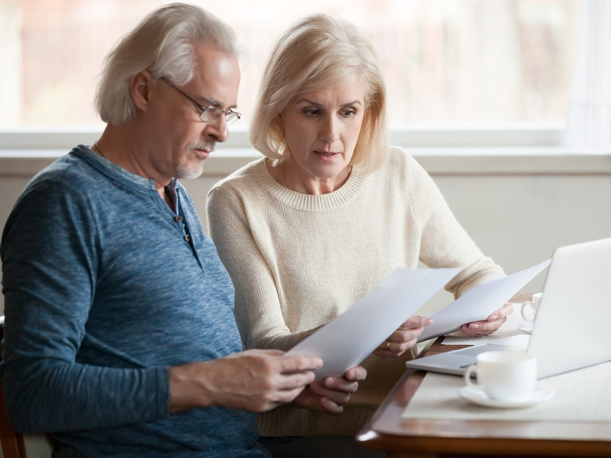 Financial meeting between middle-aged husband and wife
