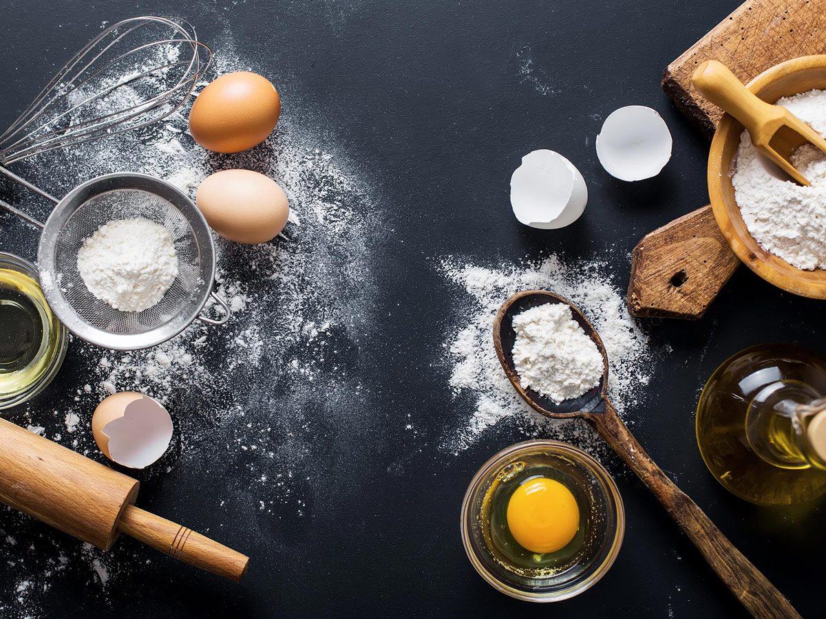 Meal prep: eggs, flour, utensil