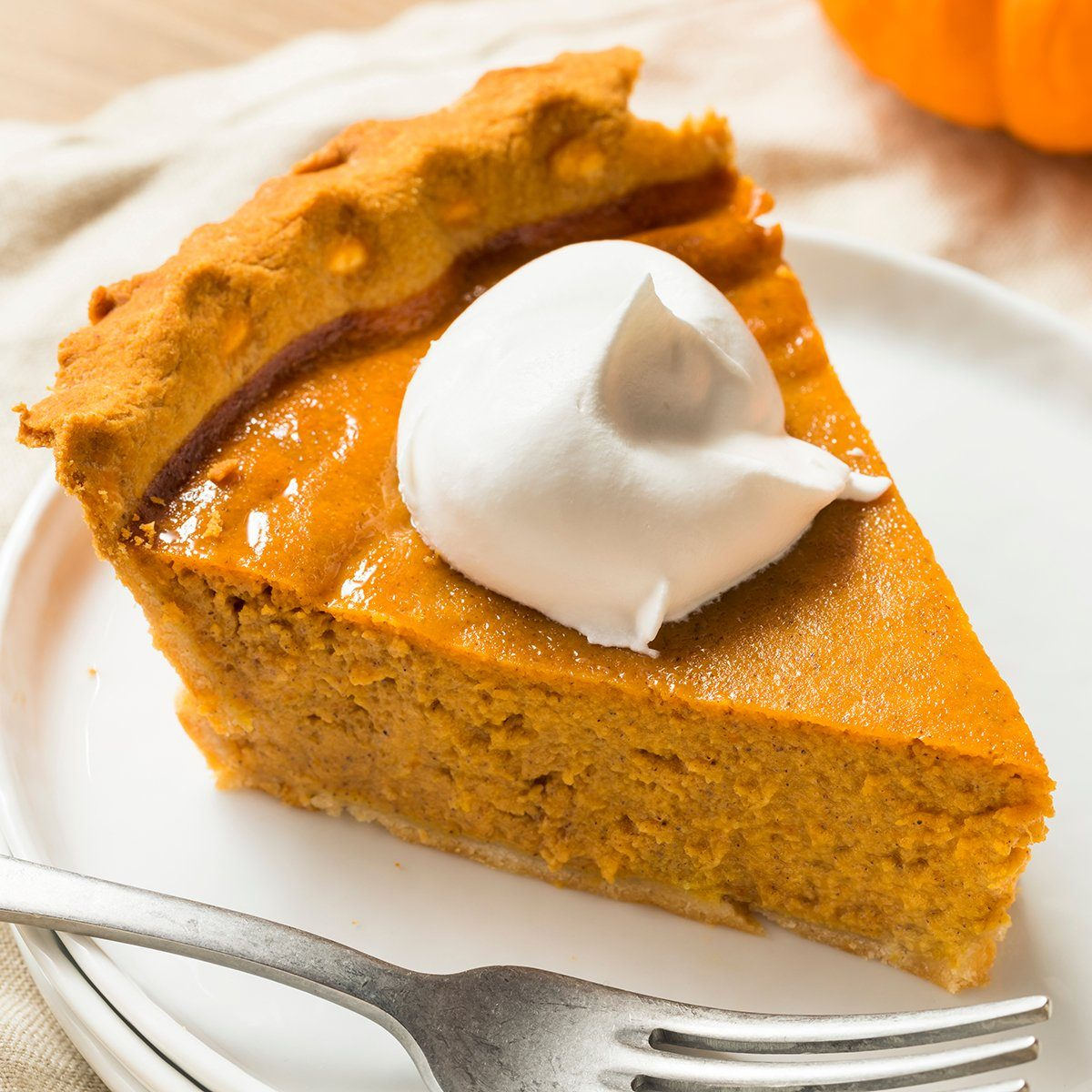 Sweet Homemade Thanksgiving Pumpkin Pie Ready to Eat; Shutterstock ID 1185116455; Job (TFH, TOH, RD, BNB, CWM, CM): TOH