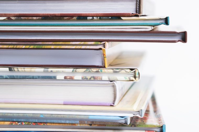 Close view of Stack of children's books on a white background