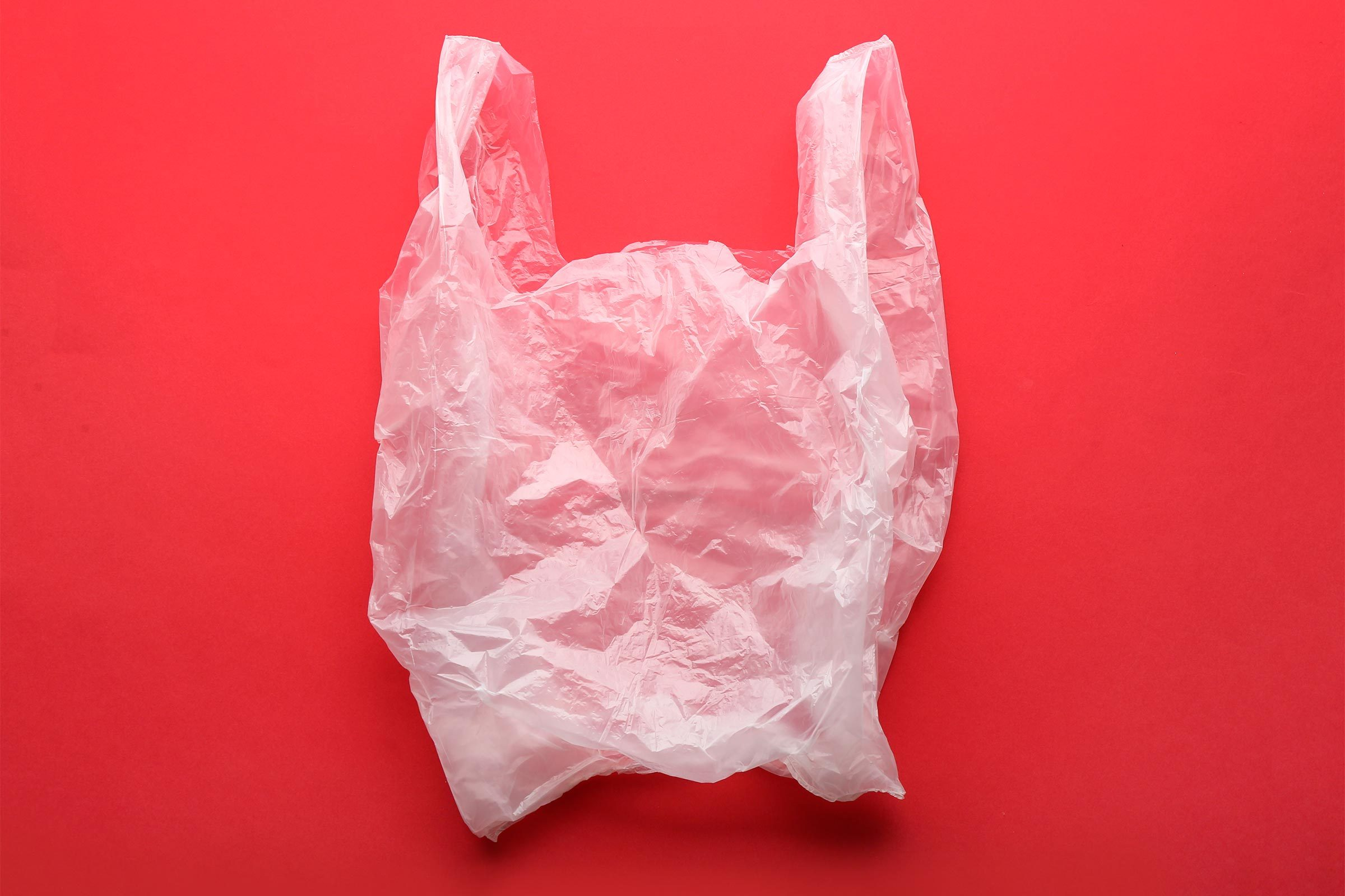 Clear disposable plastic bag on color background
