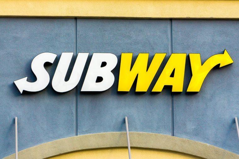 close up of exterior subway logo on a building facade