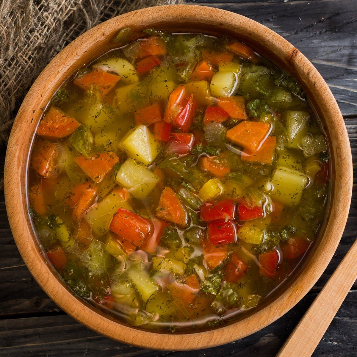 Vegetable soup in a wooden plate. Useful and tasty food.; Shutterstock ID 538094596; Job (TFH, TOH, RD, BNB, CWM, CM): TOH