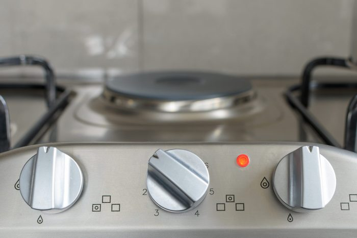 electrical stove knob in kitchen work top with operation light on