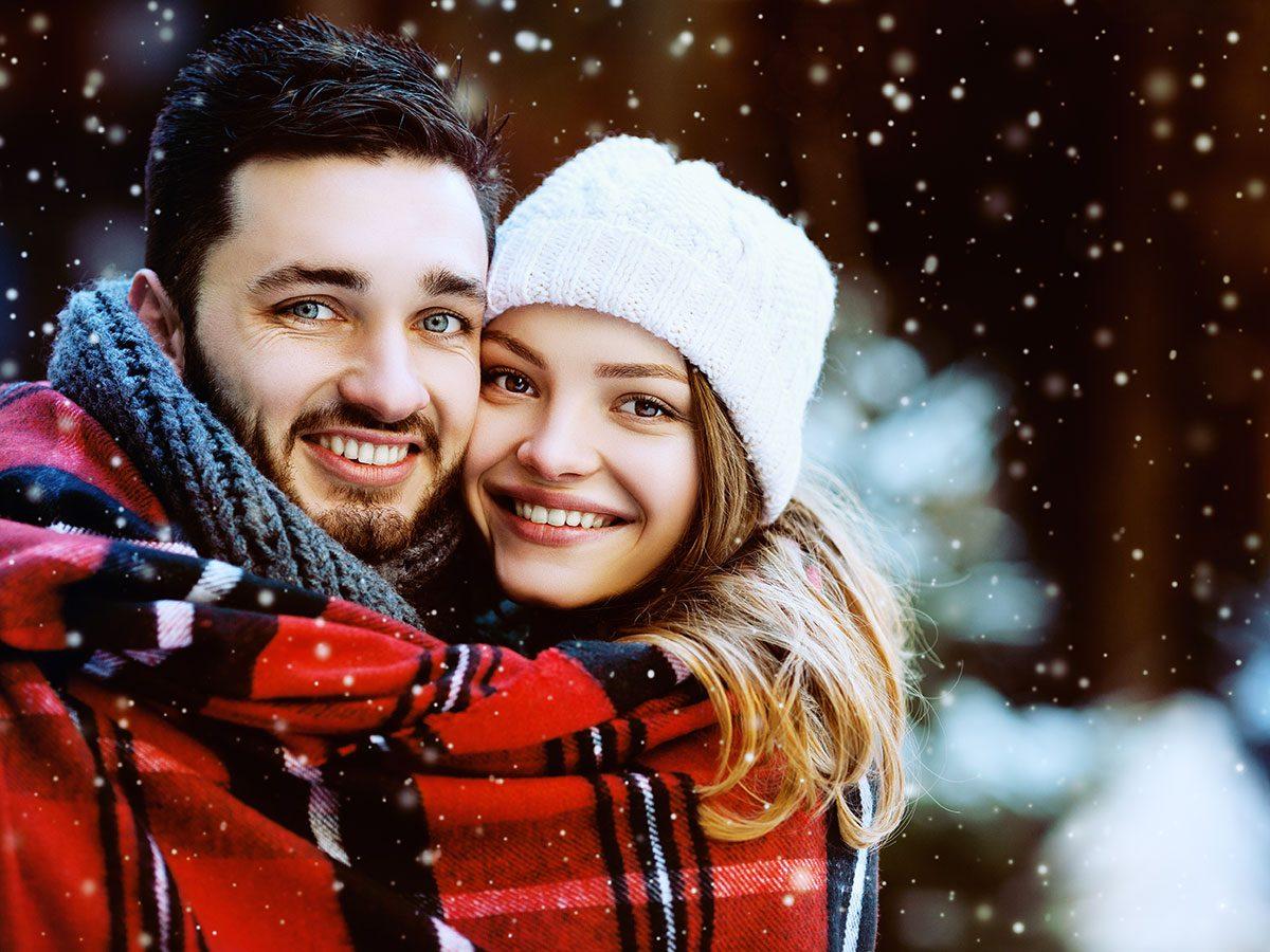 Swathed - Christmas couple bundled in blanket