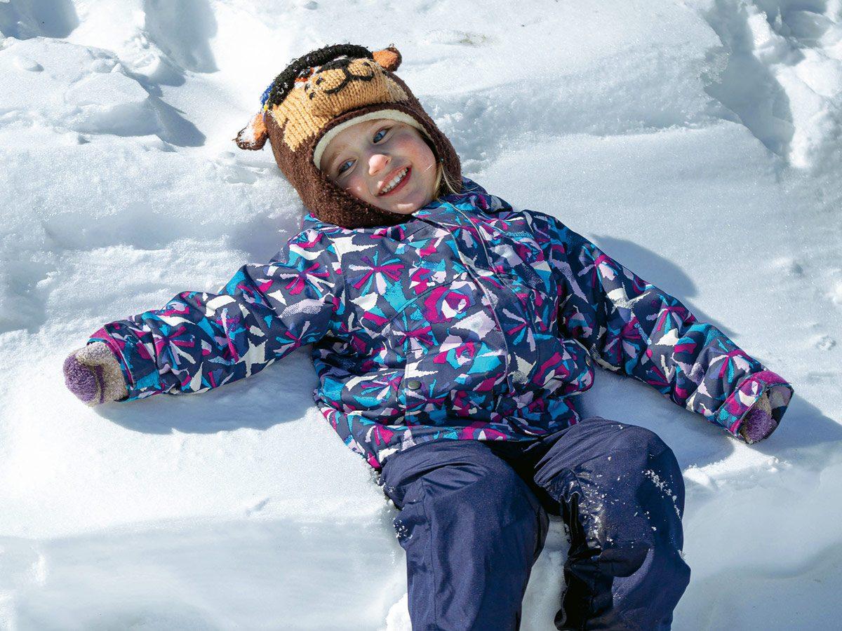 Richard's granddaughter Charlotte making snow angels