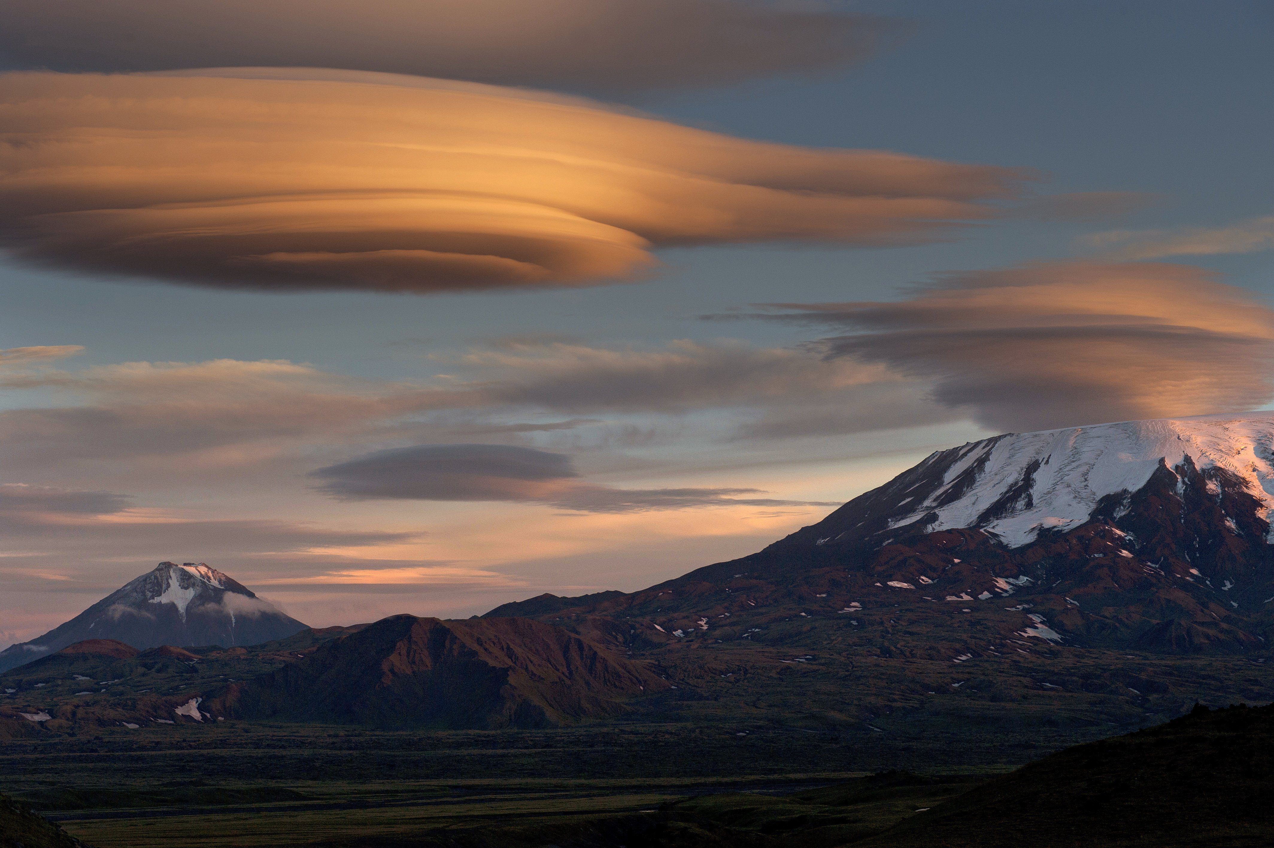 Russia, Kamchatka, a view of the volcanoes Flat Tolbachik and Ostry,lenticular cloud