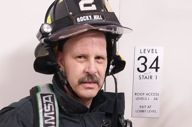 Douglas Clarke working as a volunteer firefighter in Rocky Hill, CT where he resides with his wife Wendy and son Cameron.