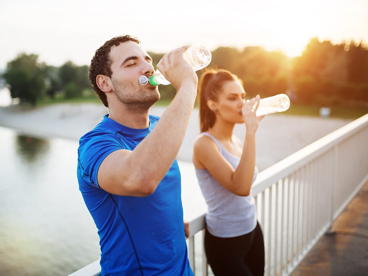 Best hydration drink - man and woman drinking water