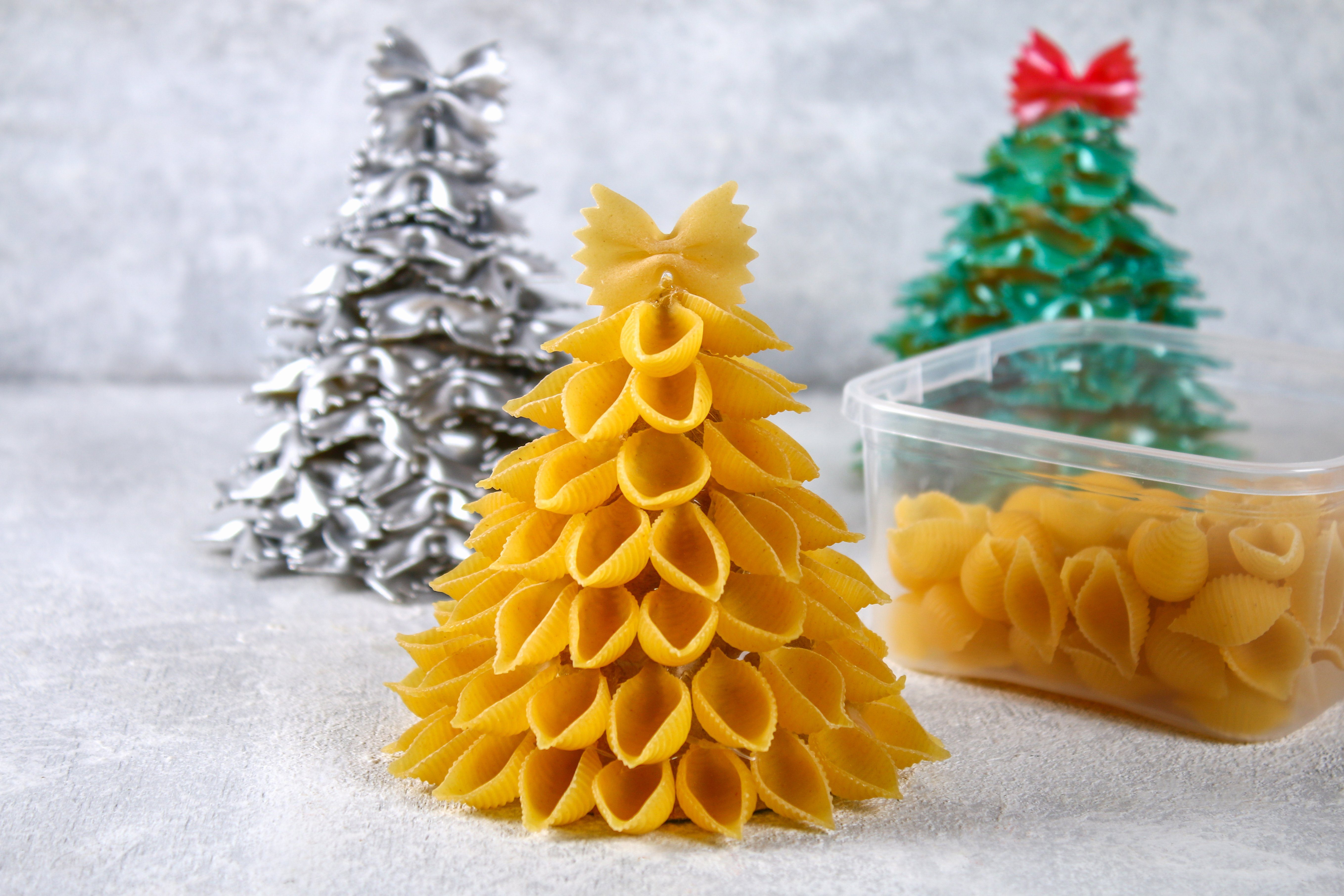How to make a Christmas tree from raw pasta conchiglie. The process of making Christmas trees from pasta, cardboard plates, hot glue and paint or spray. Guide, step by step on the photo.Handmade, DIY.